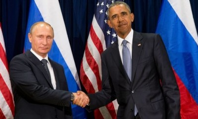 Presidents Obama and Putin handshake
