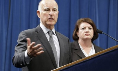 Calif., Gov. Jerry Brown answers a question concerning the budget agreement reached with legislative leaders at a Capitol news conference in Sacramento, Calif., Tuesday, June 16, 2015. Accompanied by Assembly Speaker Toni Atkins, D-San Diego, right, and Senate President Pro Tem Kevin de Leon, D-Los Angeles, unseen, Brown outlined the budget plan that send billions more to public schools and universities in the fiscal year that begins July 1. (AP Photo/Rich Pedroncelli)