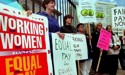 DayNews - Equal Pay Day 2000 ' Rally in front of the U.S Mint, 300 W. Colfax Ave. , Several womens groups speak out about the current wage gap for women and people of colora . smone where carrying red purses to show that women's pay is still in the red, compared