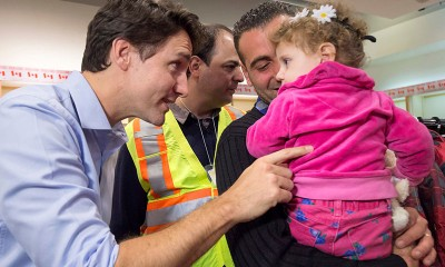 Prime Minister Justin Trudeau Greets Syrian Refugee Child