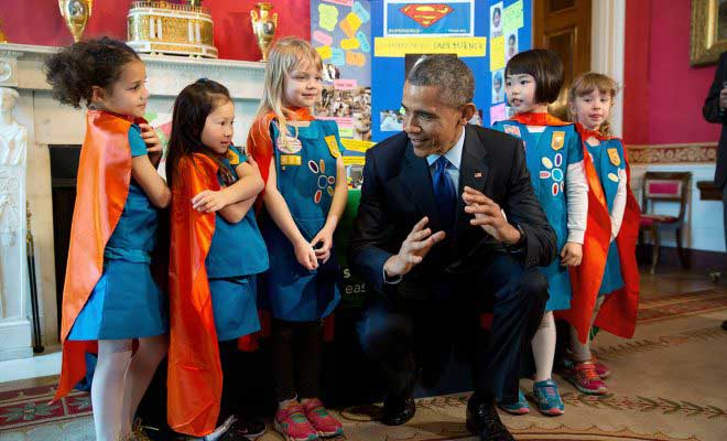 President Barack Obama views science exhibits during the 2015 White House Science Fair celebrating student winners of a broad range of science, technology, engineering, and math (STEM) competitions, in the Red Room, March 23, 2015. The President talks with Emily Bergenroth, Alicia Cutter, Karissa Cheng, Addy O'Neal, and Emery Dodson, all six-year-old Girl Scouts, from Tulsa, Oklahoma. They used Lego pieces and designed a battery-powered page turner to help people who are paralyzed or have arthritis. (Official White House Photo by Chuck Kennedy)  This official White House photograph is being made available only for publication by news organizations and/or for personal use printing by the subject(s) of the photograph. The photograph may not be manipulated in any way and may not be used in commercial or political materials, advertisements, emails, products, promotions that in any way suggests approval or endorsement of the President, the First Family, or the White House.