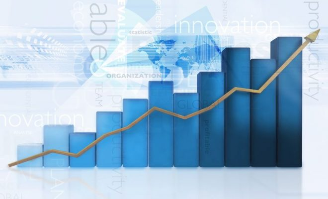 12197717 - 3d business chart showing growth - isolated over a blue background