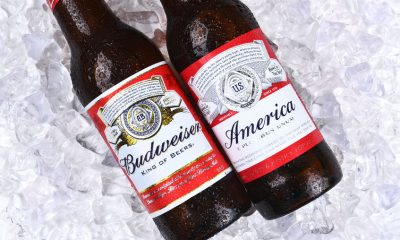 56982566 - irvine, ca - may 21, 2016: two budweiser beer bottles on ice. a limited edition america bottle and a traditional label from anheuser-busch.