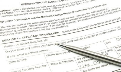 8158691 - a medicaid application ready to be filled out with a silver pen.