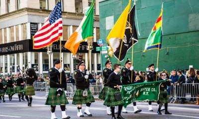54468148 - new york-march 17- marchers with flags dressed in kilts march in the st patrick�s day parade on on 5th ave in new york city.