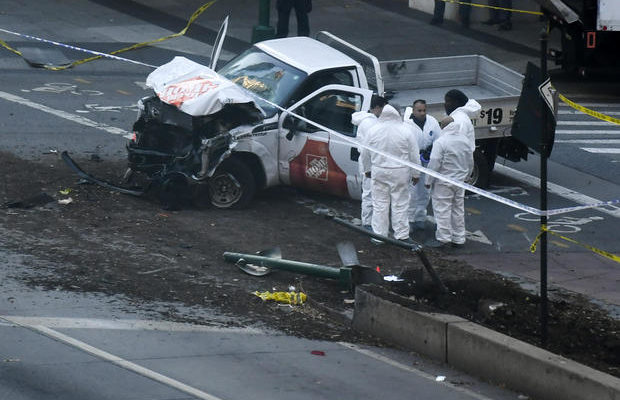 "Investigators inspect a truck following a shooting incident in New York on October 31, 2017.  Several people were killed and numerous others injured in New York on Tuesday after a vehicle plowed into a pedestrian and bike path in Lower Manhattan, police said. ""The vehicle struck multiple people on the path,"" police tweeted. ""The vehicle continued south striking another vehicle. The suspect exited the vehicle displaying imitation firearms & was shot by NYPD."" / AFP PHOTO / DON EMMERT        (Photo credit should read DON EMMERT/AFP/Getty Images)"